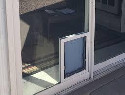 dog door in a sliding glass door