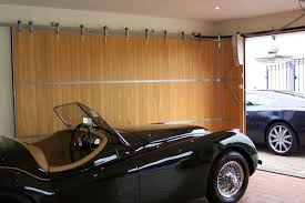 sliding garage doorsSliding and Folding Garage Doors  Garage 101