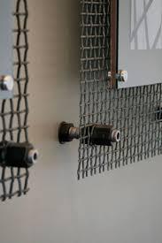 WALL ART - frame detail - looks like sheet metal, aluminum sheet and glass.