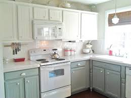 two tone painted kitchen cabinets using white and grey color and white porcelain countertops