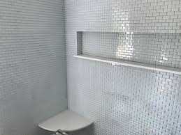 white mini glass subway tile shower wall