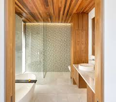 bubbly looking glass tiles on the one wall of this bathroom give the room a playful look and add a texture to the space you don t often find in bathrooms