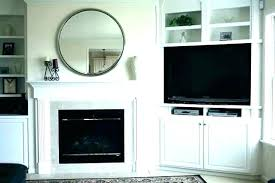 built in bookcases around fireplace ins bookshelves beside