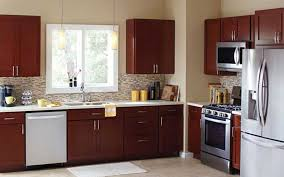 a kitchen with cabinets in a new dark wood finish affordable kitchen cabinet updates