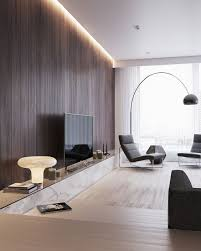 a chic modern space with light colored wooden floors and a stained wooden wall with
