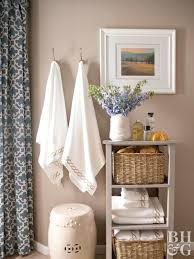 Soft Taupe Bathroom With White Towels Hanging And Folded On Taupe Shelf
