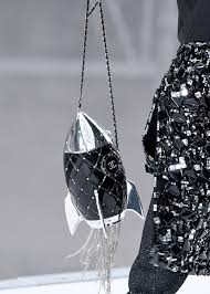 chanel rocket bag. the new collection glittered with space-age motifs, ranging from abstract to completely literal \u2013 minaudière bags in shape of rockets chanel rocket bag r