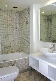 floor tiled tub shower tile ideas dark brown wooden carved drawer storage white ceramic freestanding bathtub walk in shower designs beige painting wall
