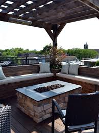 patio with fire pit and pergola. This Stone-clad Outdoor Fire Pit Is Surrounded By Comfortable Benches For Enjoying A Night Outside. Pergola Provides Structure And Shade During The Day. Patio With