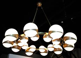 round globe chandelier with white glass on brass frame in excellent condition for in