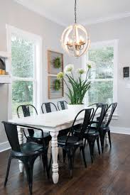white metal furniture. A White Farm Table And Dark Metal Chairs Provides Sleek Look Sharp Contrast In The Dining Room. Joanna Scoured Her Warehouse For Just Right Furniture