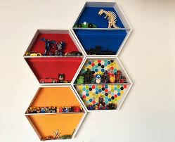 kmart hexagon shelf stacked together to create fun wall art and shelving