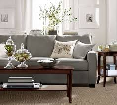 pottery barn ac w stacks of books on sofa table devin tufted rug neutral pottery barn