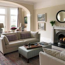 Edwardian fireplace, glass tables and reclaimed wood floor with glass  chandelier. Living room ideas