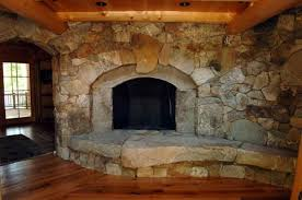 ancient stone fireplace hearth in traditional living room design