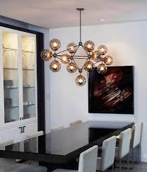 jason miller modo chandelier over dining room table