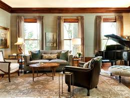 classical living room with pretty seats amd round wooden table along with a grand piano and