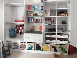 custom multiuse closet wall unit and storage cabinets for a child s bedroom