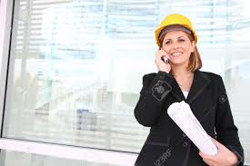 Buiding Manager A Woman Construction Manager On A Building Site Talking On Phone