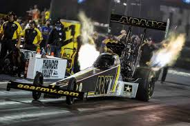 tony schumacher does a burnout in his top fuel dragster during qualifying at the 2016 nhra