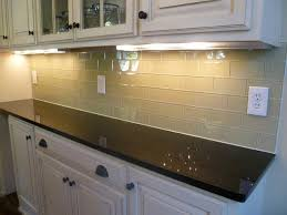 simple kitchen with light brown glass subway tile