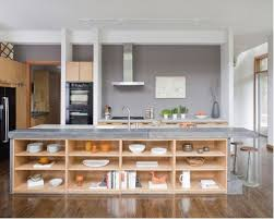 Example of a trendy kitchen design in Atlanta with black appliances, open  cabinets, light