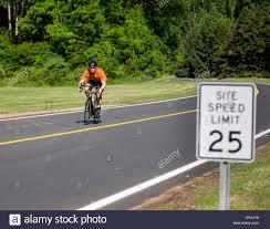 Man Riding A Road Bike On A Paved Roadway Stock Photo 83081245 Alamy