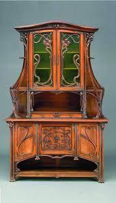 art nouveau furniture. french art nouveau cabinet. walnut and glass. france. circa 1900-1910. furniture m