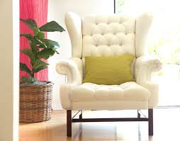 no wonder we all love white slip covered sofas or white fabric chairs they are the perfect starting points for so many creative decor styles