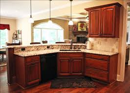 custom home kitchen stained wood cabinetry dining room pass through granite countertops madison custom homes inc indianapolis