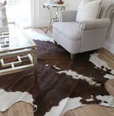 chocolate brown and white cowhide rug