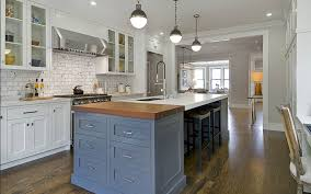 kitchen island with a sink seating and storage