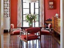a set of midcentury chairs in a room by designer michael berman