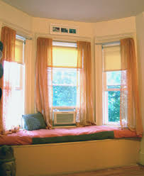 A bay curtain rod, customized in the size of your curtains in the shape of  the area, can allow you to hang drapes that will cover all three windows  with ...