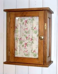 vintage glazed pine wall cabinet