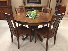 amish built by fusion designs the charleston pedestal table features 1 thick solid wood tops shown as a 54 round solid elm dining table
