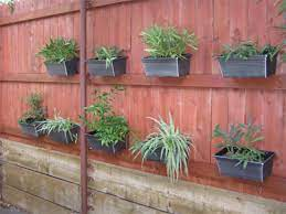 fence garden how to hang flower pots
