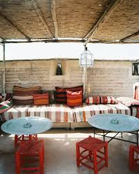 moroccan garden furniture. an outdoor lounge area furnished with striped cushions via lonny moroccan garden furniture h