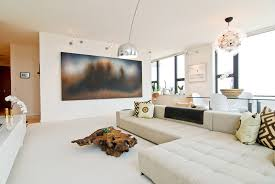 modern living lighting. mid century modern living room with large sofa and cool lighting