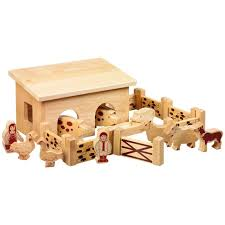 reverse view of natural wood small barn building with farm animals people walls