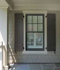 Brown window and shutter, cream? trim, taupe siding   colors for ginny .