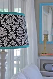 white lamp shade with black trim post navy blue and shades base