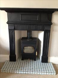 reclaimed cast iron surround fired earth tiles toasty