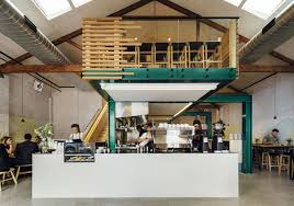 This contemporary coffee shop combines wooden elements with colors such as  white and jade.