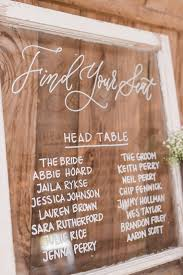 Hand Written Seating Chart On Glass For Columbus Oh Wedding