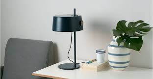 a table light in slate blue and brass designed by james burgess