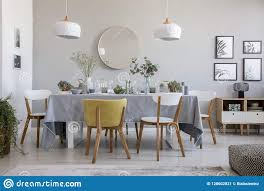 Elegant Lighting Mirrored Furniture Elegant Dining Room Interior With A Laid Table Chairs