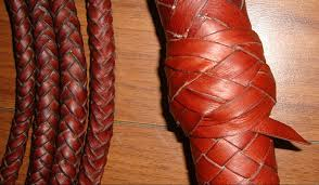 picture the turk s head knot marking the end of the whip handle the white