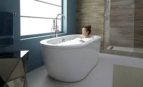 freestanding bath tubs woman taking a in her bathtub bathtubs with end drain freestanding bath tubs