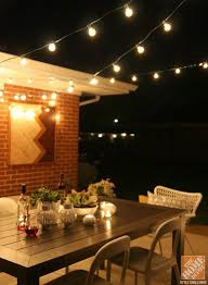 a patio with outdoor string lights is the perfect spot for a romantic night in
